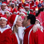 [UNVERIFIED CONTENT] MADRID, SPAIN - DECEMBER 14: A couple kiss across the finish line after the circuit of popular 5.5k Santa Claus race in Madrid. Six thousand runners dressed in Santa Claus costume flooded the Paseo de la Castellana in the second edition of this popular pre-Christmas career that welcome Christmas occurs, considered one of the most fun races are held in the city on Saturday December 14, 2013, in Madrid, Spain. For a distance of 5.5k, starting and finishing near the Santiago Bernabeu stadium, adults dressed in Santa Claus costume and children green elf uniform, in a career that is destined to be one of the most fun take place in the city. For the first time in a popular Spanish female participation career, which reached 51 percent, was higher than the male. (Photo by Hugo Ortuño/Getty Images)